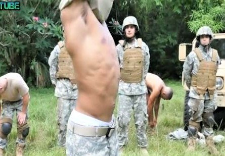 Tattooed soldier banging his friend